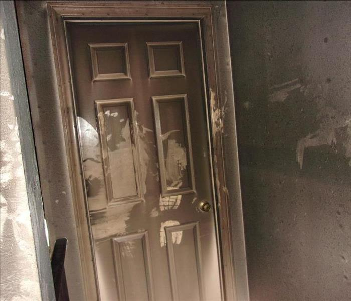 white door covered with smoke and soot